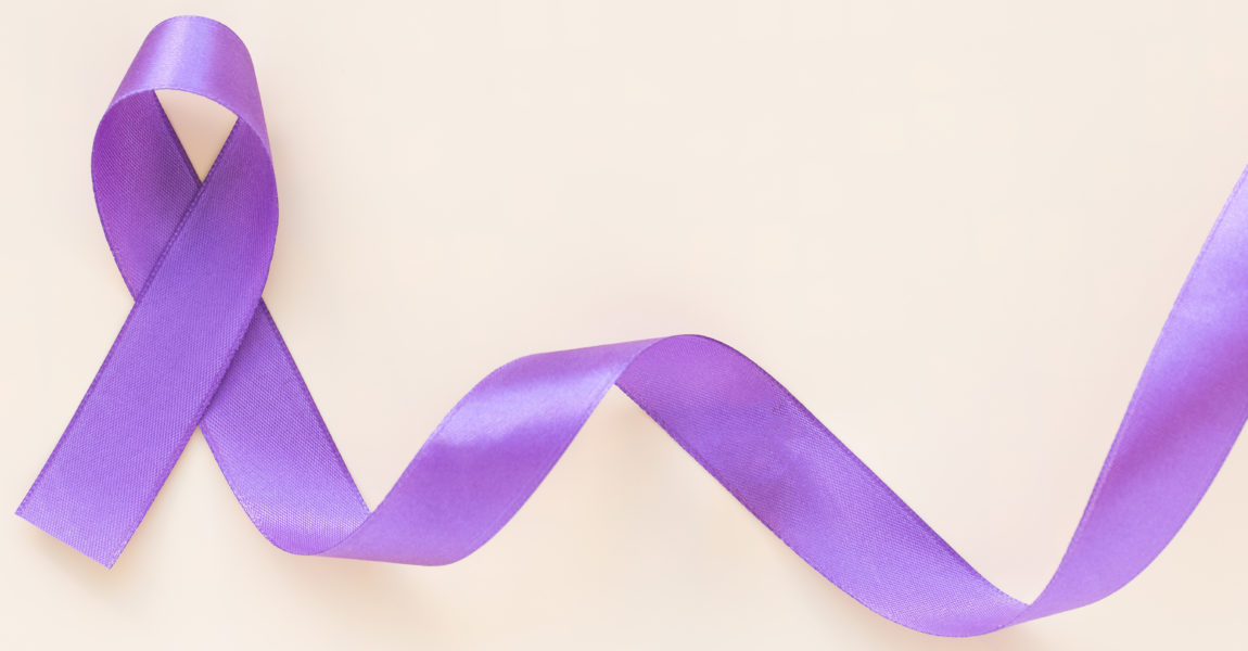 Purple ribbon bow on white fabric with copy space. Hodgkin Lymphoma Awareness, Testicular Cancer, Alzheimer disease, Epilepsy awareness, World Cancer Day. Healthcare or hospital and insurance concept